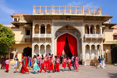 Local school kids walking out of Rajendra Pol in Jaipur City Palace. Rajasthan, India. Palace was the seat of the Maharaja of Jaipur, the head of the Kachwaha royalty free stock photography
