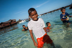A local sea gypsy kid. SEMPORNA, Sabah, Malaysia. Children live here do not attend school for lack of means and resources Royalty Free Stock Image