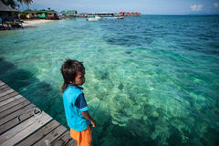A local sea gypsy kid. SEMPORNA, Sabah, Malaysia. Children live here do not attend school for lack of means and resources stock photo