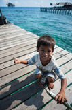 A local sea gypsy kid. SEMPORNA, Sabah, Malaysia. Children live here do not attend school for lack of means and resources Stock Images