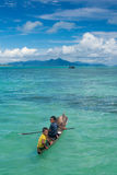 Local sea gypsy kids and their playground - the ocean. Children Stock Photos