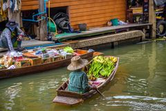 Local seller with bananas at a floating market in Thailand Royalty Free Stock Photography
