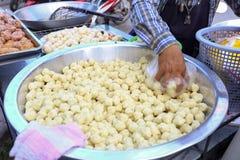 Local seller make Thai fried sweet potato ball, Khanom Khai Nok Kratha royalty free stock photography