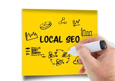 Local Seo graphic on a post-it. Hand with pen drawing it. Stock Photography