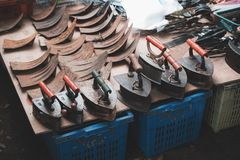 Local shop in market selling an old steel coal irons. A local shop in market selling an old steel coal irons royalty free stock image