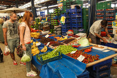 Local shoppers buy vegetables Royalty Free Stock Photo