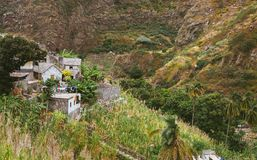 Local stone houses of small village between lush green vegetation and mountain landscape. Santo Antao Cape Verde stock photo