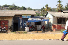 Local stores in Mwanza Tanzania. MWANZA, TANZANIA - JUNE 11: local stores with maize put out in the sun to dry along the road on June 11, 2013 in Mwanza Stock Image