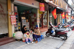 Local street food vendor at a corner in Hanoi's Old Quarter . Stock Photography