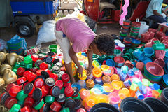 Local street vendor selling plastic products Stock Image