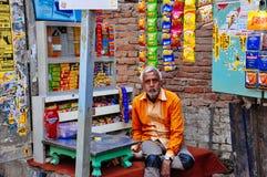 A local street vendor in Varanasi, India. A local street vendor tends to his shop in Varanasi, India stock photo