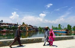 Local strolling on the Dal Lake promenade Royalty Free Stock Photo