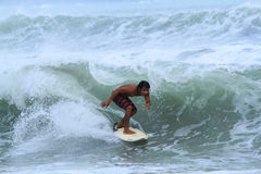 Local Surfer at Bali. Surfer in Kuta, Bali Indonesia Stock Images