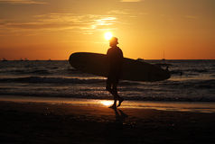 Local surfer at sunset Stock Photo