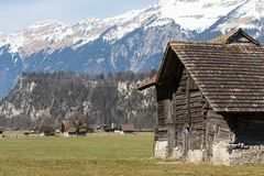 Local Swiss Alps mountain scenery of a little village close to Brienz, Switzerland stock image