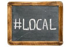 Local tag. Local hashtag handwritten on vintage school slate board stock photo