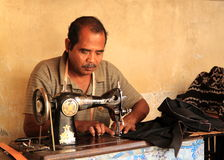 Indonesian tailor man Stock Image