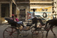 Local taxi with horse in motion with che and cuba flag graffiti Stock Photo