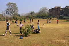 Local teenagers playing in a field at Ranthambore Fort, India Royalty Free Stock Photo