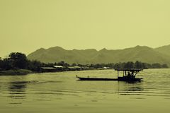 Local thai Ferry Transport on riverkwai river at kanchanaburi province thailand sepia. Local thai Ferry Transport on riverkwai river at kanchanaburi province Royalty Free Stock Image