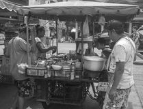 Local Thai street food cart. In and around Thailand you see many street food vendors who have modified a motorcycle with an attached side cart that becomes Royalty Free Stock Photos