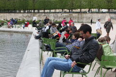 Local and Tourist in the famous Tuileries gard Royalty Free Stock Photos
