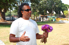 Local tourist guide with bouquet of lilies Royalty Free Stock Photos