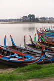 Local tourist sight seeing boat front of U Bein bridge Royalty Free Stock Photography