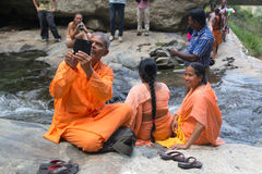 Local tourist taking photos with mobile phone at Ravana falls Royalty Free Stock Photo