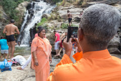 Local tourist taking photos with mobile phone at Ravana falls Stock Photos