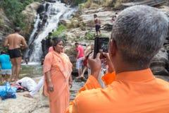 Local tourist taking photos with mobile phone at Ravana falls stock photos