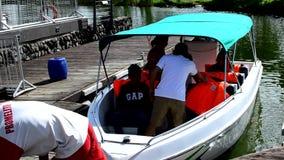 Local tourists ride on passenger motor boat on manmade river. Nuvali states, Santa Rosa City, Laguna, Philippines - October 28, 2016: Local tourists ride on stock video