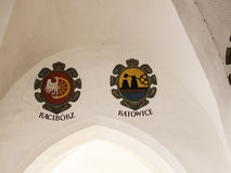 Local Town coats of arms in the Cloth Hall on the main Market Square in Krakow, Poland is a haven for shopping Royalty Free Stock Image