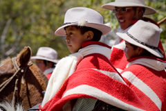 Local town festivities in Pintag, Pichincha. PICHINCHA, ECUADOR - OCTOBER 10, 2010: Unknown local indigenous boys celebrating local festivities in Pintag Royalty Free Stock Photo