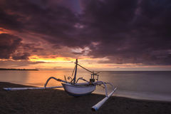 Local traditional boat under the burning sky Stock Photography