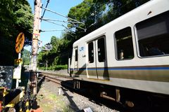 Local train in Arashiyama. Kyoto. Japan. Arashiyama is a district on the western outskirts of Kyoto Stock Photo