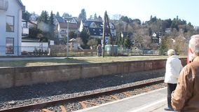 Local train arrives at a station. BAD MUENSTEREIFEL - APRIL 7: Local train arrives at a station in Bad Muenstereifel, Germany on April 7, 2013. Bad Muenstereifel stock video