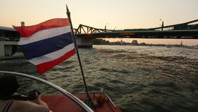 Local transport boat on Chao Phraya river in Bangkok stock video