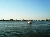 Local transport boat crossing river, Danube Delta, Tulcea stock image