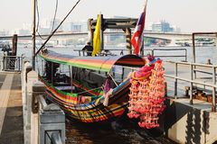 Local transport boat and river taxi on Chao Phraya River in Bangkok, Thailand. Bangkok, Thailand - January 29, 2016: Local transport boat and taxi decorated Royalty Free Stock Photography