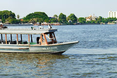 Local transport boat and river taxi on Chao Phraya River in Bangkok, Thailand. Bangkok, Thailand - December 8, 2015: Tourist the popular boat travel on the Chao Royalty Free Stock Image