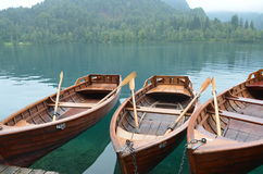 Local transport in Lake Bled, Slovenia. Boats for hire in historic Lake Bled, Slovenia Stock Photography