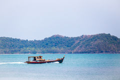 Local transport ship carrying goods to Langkawi island Stock Photos