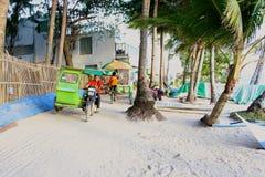 Local trike drivers taking tourists around the island Royalty Free Stock Photo