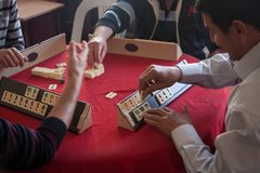 Local turkish men playing very table game Okey, or rummikub, in. Antalya,Turkey -aprill 22, 2012: Local turkish men playing very popular local table game Okey Stock Photos