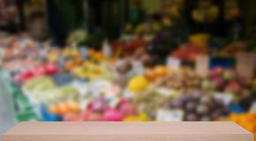 Vegetable market defocus background with wooden sheif Royalty Free Stock Images