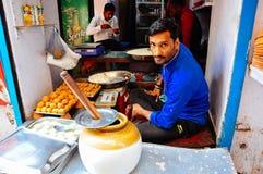 Local vendor in Varanasi, India. Local vendor sits in his shop in Varanasi, India stock photography