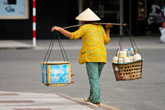 Local Vietnamese. A local Vietnamese woman hawker in Ho Chi Minh city.  Using the most basic tools as her mobile store, her stock includes ice water, fruits Stock Image
