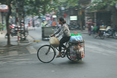 Local Vietnamese riding bicycle on the streets of Hanoi Stock Photos