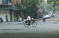 Local Vietnamese riding bicycle on the streets of Hanoi - Series 2 Stock Photography